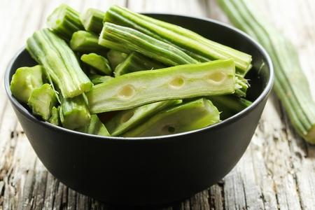 malungay: Fresh Moringa  Medicinal moringa oleifera cut in pieces on wooden background, selective focus