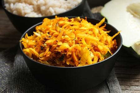 stir fry: Papaya stir fry with turmeric and coconut, selective focus