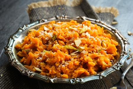 nus: Carrot Halwa  Popular Indian sweet using carrots ghee and nus Stock Photo