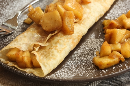 crepes: Apple crepes  caramel apple Crepes - crepes with caramelized apples close up selective focus