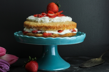 moody background: Strawberry Shortcake topped with fresh strawberries and cream  Strawberry cream cake on moody background, selective focus Stock Photo