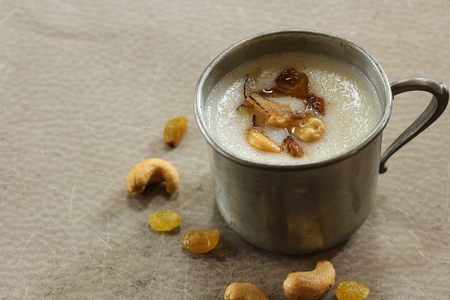 farina: Thari Kanji  Semolina Kheer - Traditional ramadan food of Kerala made of semolina milk ghee and nuts, selective focus Stock Photo