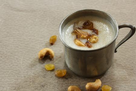 Thari Kanji  Semolina Kheer - Traditional ramadan food of Kerala made of semolina milk ghee and nuts, selective focus Stock Photo