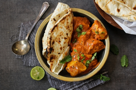 naan: Butter chicken served with Homemade Indian Naan Bread  Murgh Makhani
