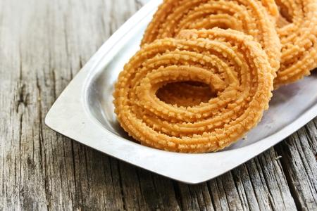 Murukku  Chakli - indian Crunchy savory Diwali snack, selective focus