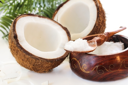 Coconut oil with fresh coconuts on side, selective focus Stock Photo - 65649419