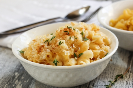 Homemade baked Mac and cheese served in a bowl, selective focus Foto de archivo