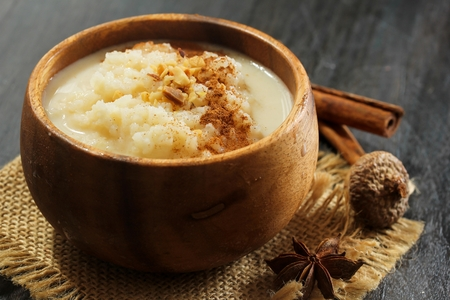 Rice Pudding topped with nuts and cinnamon powder, selective focus