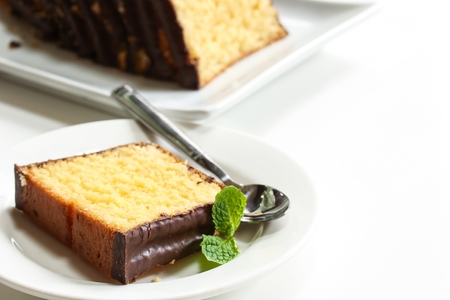 dessert plate: Slices of pound cake on a white dessert plate isolated on white