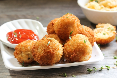 ketch: Fried Mac and Cheese balls served with ketch up, selective focus