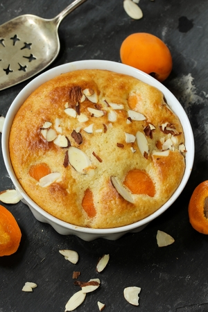 Apricot Pudding  apricot Clafoutis on dark gray background