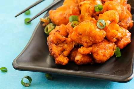 florets: Gobi Manchurian  Indo Chinese Appetizer made with cauliflower florets, selective focus