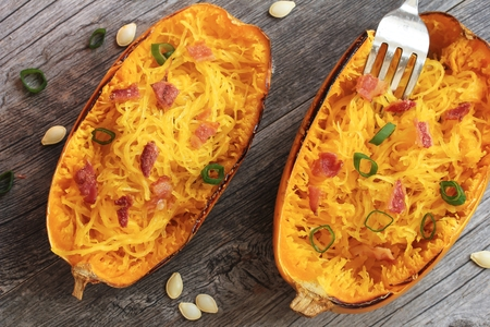 Spaghetti squash with bacon and spring onion topping top down view