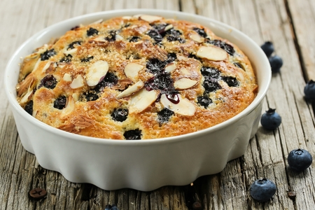 Homemade blueberry pudding cake on wooden background, selective focus Stock Photo