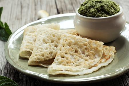 dosa: Rice Dosa  Rice Crepes - Gluten free unfermented Dosa with rice flour serve with mint chutney Stock Photo