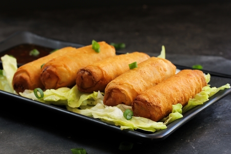 serving dish: Spring Rolls on traditional Chinese serving dish Stock Photo