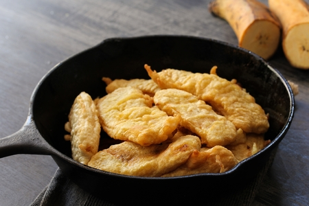 Banana fritters / Pazham Pori - Btter fried kerala snack with ripe plantains, selective focus