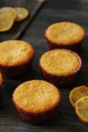 moody background: Homemade Lemon cupcakes oon  dark moody background, selective focus Stock Photo