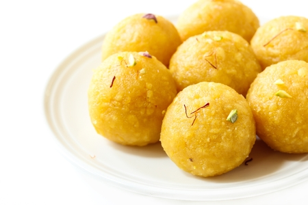 Laddu  Ladoo -Indian Festival Sweets made of chickpea flour ghee and nuts  Diwali sweets, selective focus