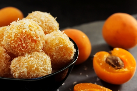 Protein balls with apricots and coconuts  apricot Energy balls, selective focus