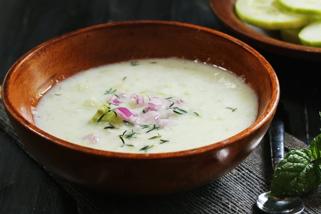 moody background: Chilled Cucumber Soup on dark moody background, selective focus Stock Photo