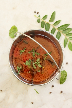 south indian: Rasam - South Indian soup using tamarind water tomatoes and lentil, selective focus