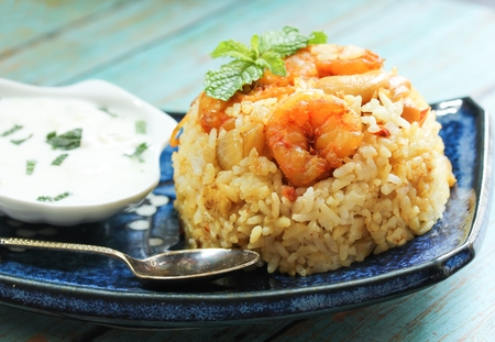 Prawn Biryani  Shrimp Biryani served with Yogurt Raita, selective focus Stock Photo