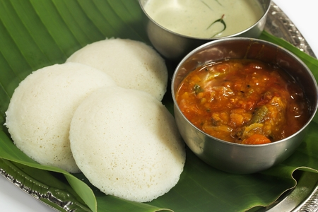 Idli  with Sambar and Coconut Chutney served in banana leaf - Popular South Indian breakfast, selective focus Stock Photo