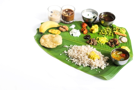 feast: Onam Feast - Vegetarian meal served in banana leaf on the occasion of Onam festival, selective focus