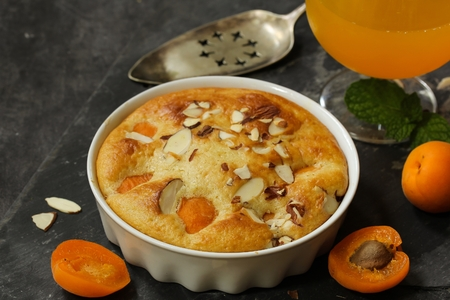 Apricot pudding cake  Summer fruit cake with fresh Apricots, selective focus