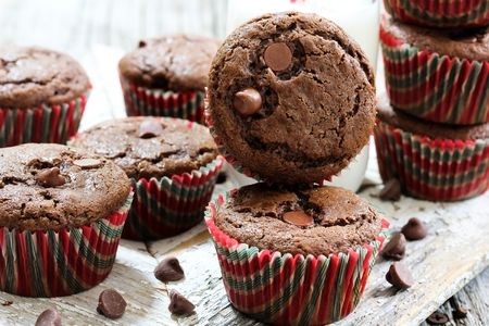 Homemade chocolate muffins with bottle of milk on side, selective focus
