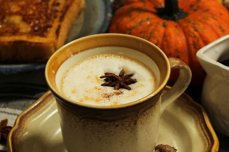 te: Pumpkin Spice Chai Latte served with Pumpkin french Toast on Autumn background  Autumn breakfast, selective focus