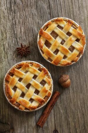 Homemade Mini apple Pies  Mini apple tarts on wooden background, overhead view