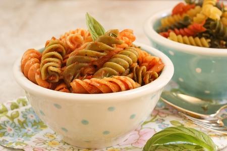 marinara sauce: Rotini Pasta with basil Tomato Sauce  Pasta in a bowl, selective focus Stock Photo