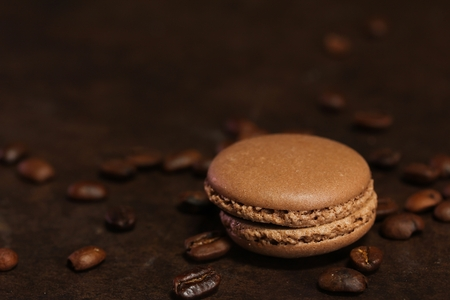 moody background: Chocolate Macaron  French macaron cookies on dark moody background, selective focus