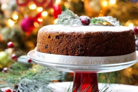 Homemade Christmas fruit cake on Holiday bokeh background, selective focus Stock Photo