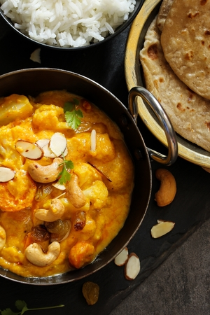 Vegetable or Navratan Korma - Indian Mixed Veg Curry served with Roti and rice Stock Photo