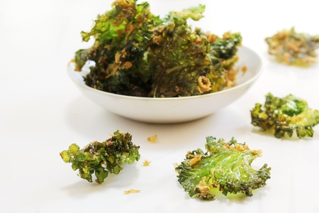Kale chips isolated on white