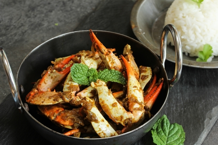 Crab Masala Roast served with cooked Jasmin rice Stock Photo