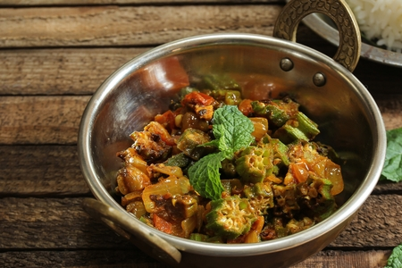 Bhindi Masala or Fry  / Okra cooked with onions tomatoes and spices, selective focus Reklamní fotografie - 87726944