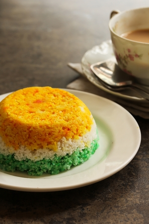 Indian Flag Food Tri Color Steamed rice cake or Puttu  for Independence Day, selective focus