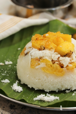 Kerala Ethakka Puttu  Steamed rice coconut cake with ripe plantains, selective focus