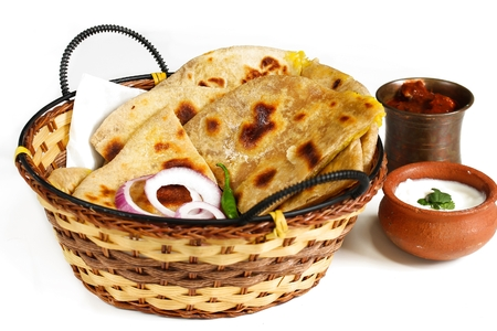 Aloo Paratha served in a  basket isolated on white, selective focus