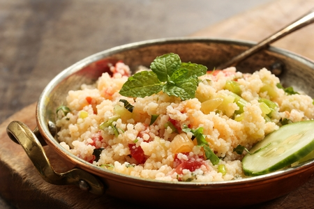 Tabbouleh Salad - Popular vegetarian Mediterranean dish made of fresh cucumber,tomatoes,parsley and coucous Reklamní fotografie