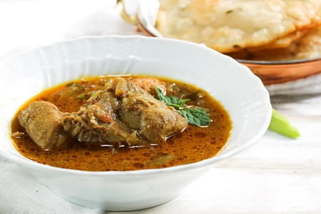 Kerala Chicken Curry served with Pathiri