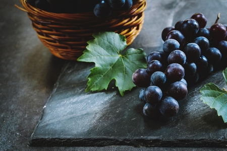 Fresh Concord grapes still life, selective focus