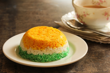 Indian Flag Food Tri Color Steamed rice cake or Puttu  for Indipendence Day, selective focus