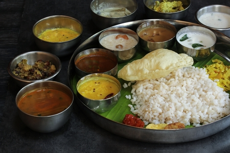 South Indian Vegetarian Thali served in a Round Steel plate, selective focus Stock Photo