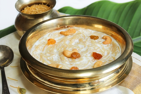 Close up of Semiya Kheer served in Traditional Brass vessel, selective focus