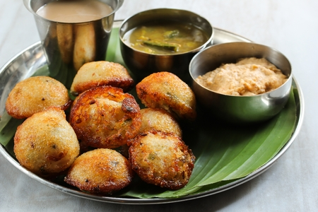 Kuzhi Paniyaram served with coconut chutney and sambar- South Indian breakfast with black  lentils and rice